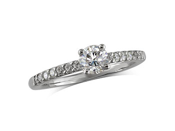 Platinum set single stone diamond engagement ring, with a certificated brilliant cut centre in a four claw setting, and diamond set shoulders. Total diamond weight: 0.54ct.