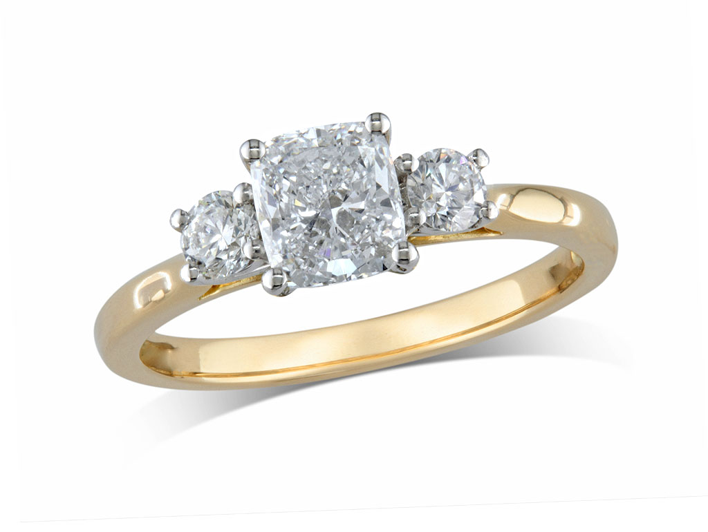 18 carat yellow gold set three stone diamond engagement ring, with a certificated cushion cut centre in a four claw setting, and one brilliant cut on each shoulder. Total diamond weight: 1.43ct.