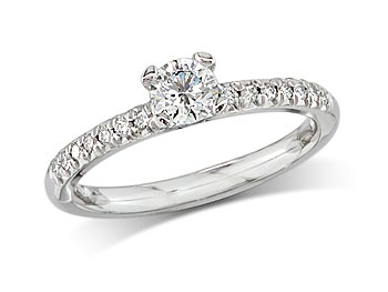Platinum set single stone diamond engagement ring, with a certificated brilliant cut centre in a four claw setting, and diamond set shoulders. Total diamond weight: 0.78ct.