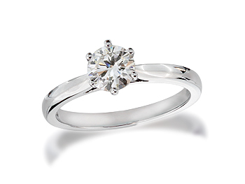 Platinum set single stone diamond engagement ring, with a certificated brilliant cut, in a six claw setting.
