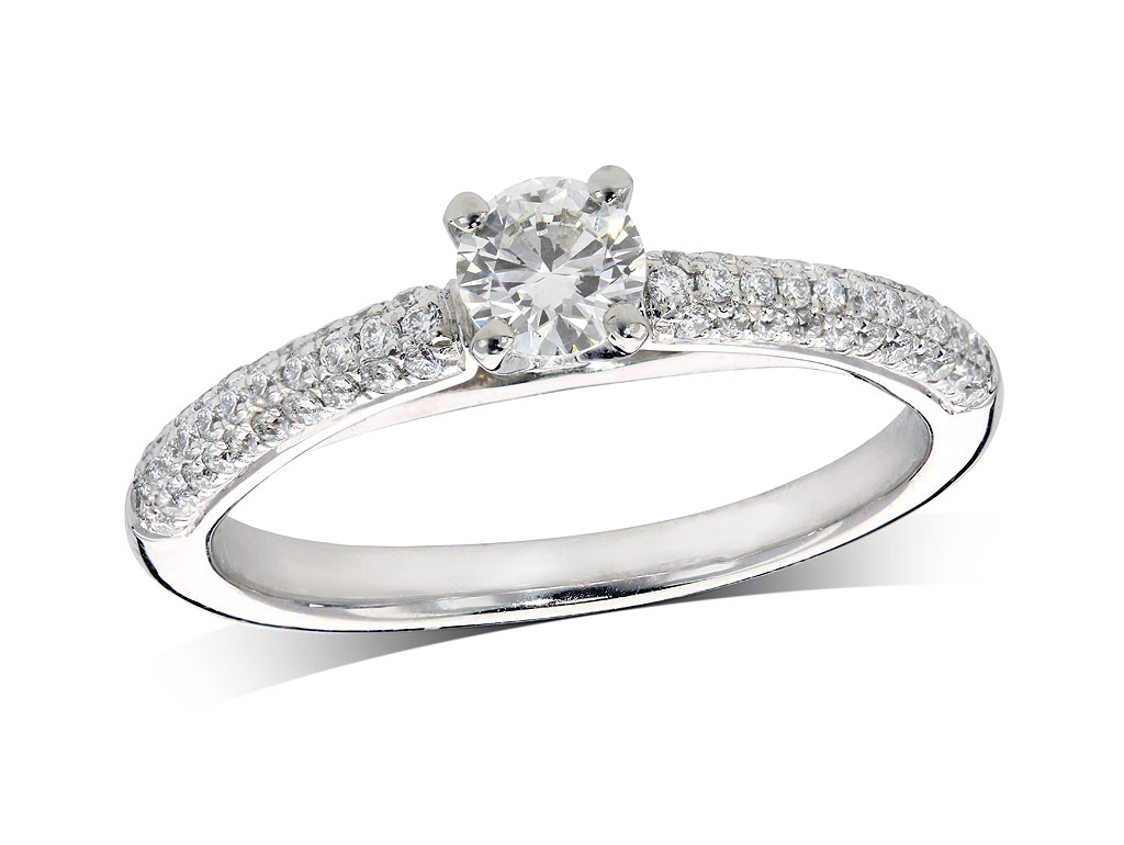 Platinum set single stone diamond engagement ring, with a certificated brilliant cut centre in a four claw setting, and diamond set shoulders. Total diamond weight: 0.55ct.