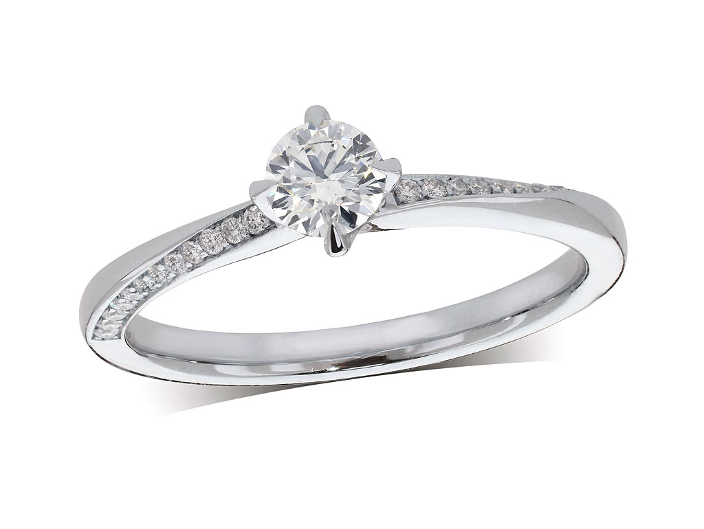 Platinum set single stone diamond engagement ring, with a certificated brilliant cut centre in a four claw setting, and diamond set shoulders. Perfect fit with a wedding ring. Total diamond weight: 0.30ct.