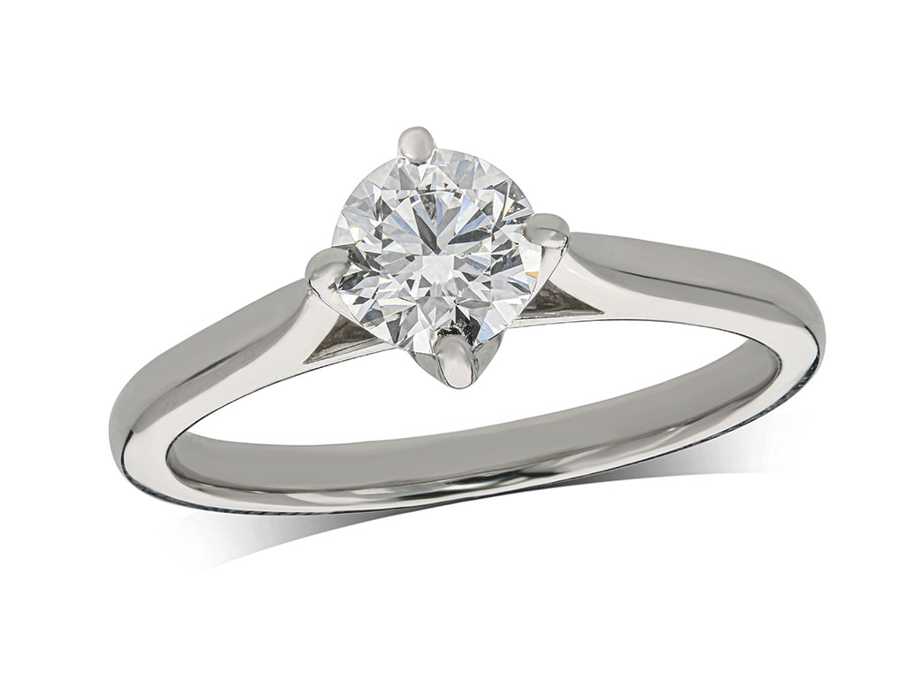 Platinum set single stone diamond engagement ring, with a certificated brilliant cut centre in a four claw setting. Total diamond weight: 0.70ct.