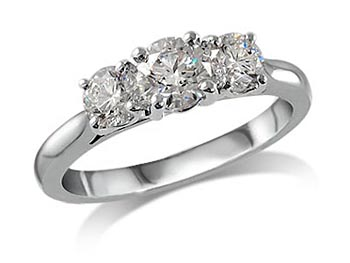 Platinum set three stone diamond engagement ring, with a certificated brilliant cut centre in a four claw setting, and one brilliant cut on each shoulder. Perfect fit with a wedding ring. Total diamond weight: 1.33ct.