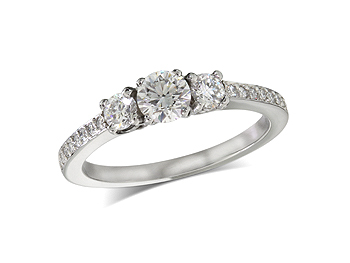 Platinum set three stone diamond engagement ring, with a certificated brilliant cut centre in a four claw setting, and one brilliant cut with diamond set shoulders on each side. Total diamond weight: 0.65ct.