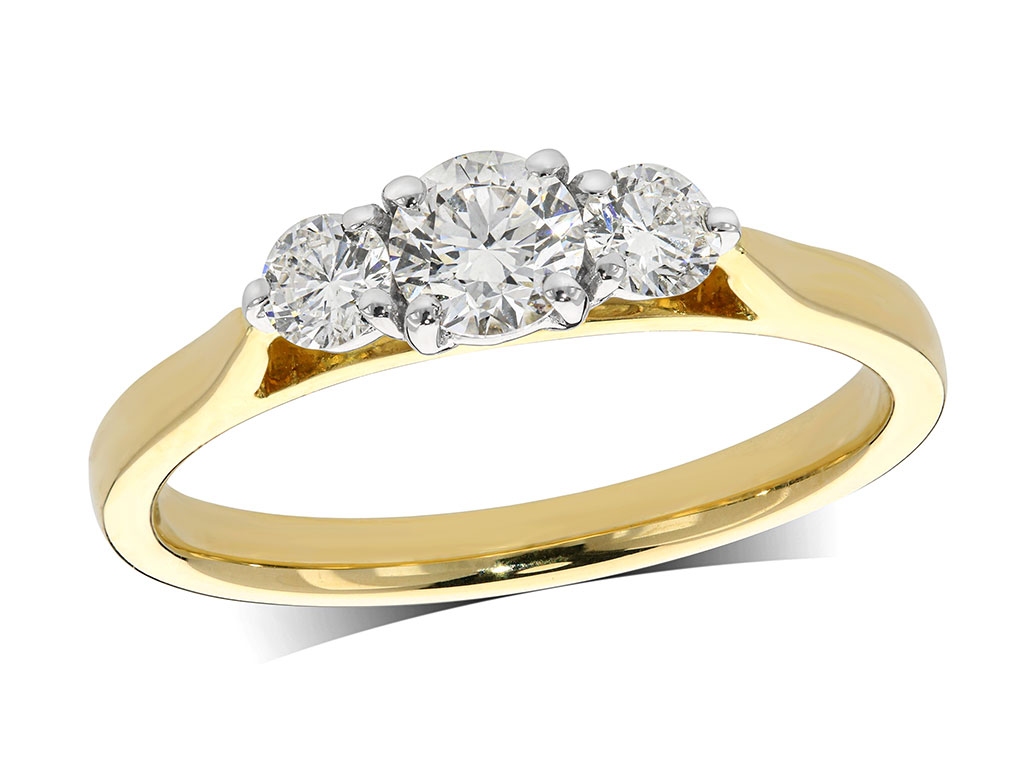 18 carat yellow gold set three stone diamond engagement ring, with a certificated brilliant cut centre in a four claw setting, and one brilliant cut on each shoulder. Perfect fit with a wedding ring. Total diamond weight: 0.51ct.