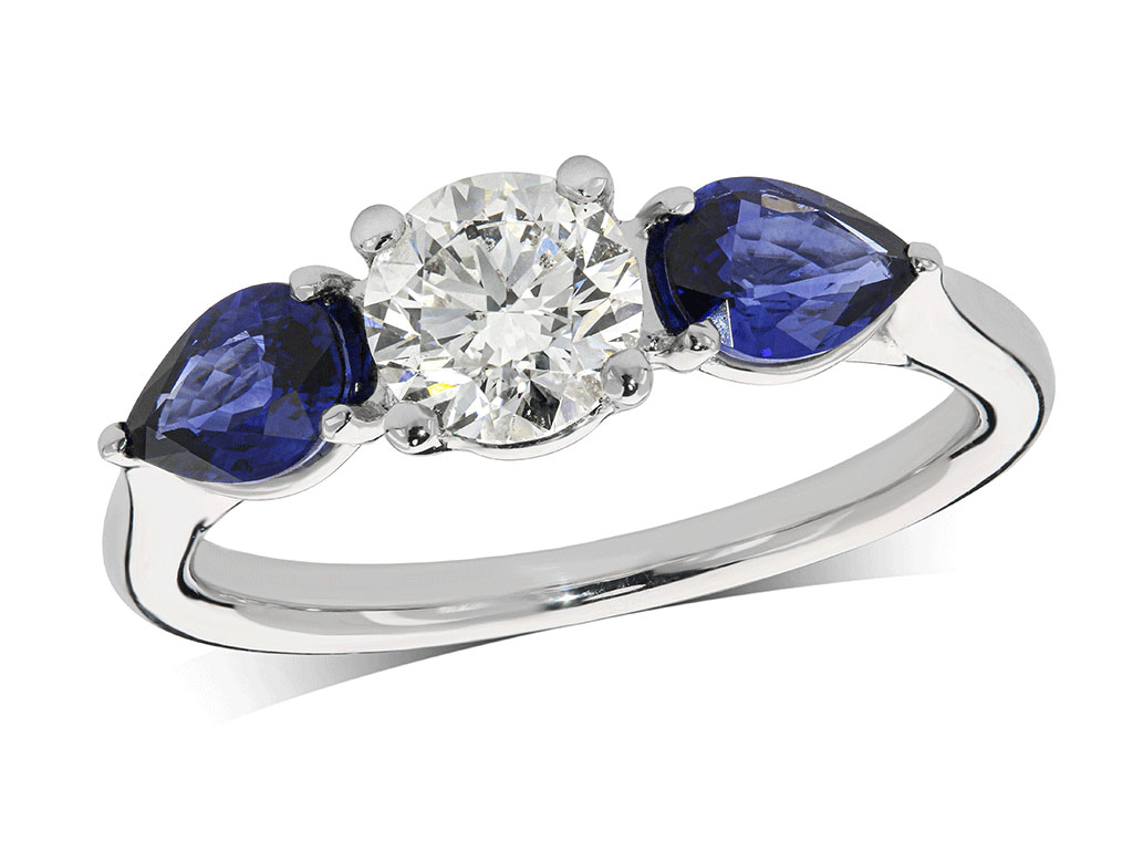 Platinum set three stone engagement ring, with a certificated brilliant cut centre in a four claw setting, and one pear shaped sapphire on each shoulder. Perfect fit with a wedding ring. Total carat weight: 1.68ct.