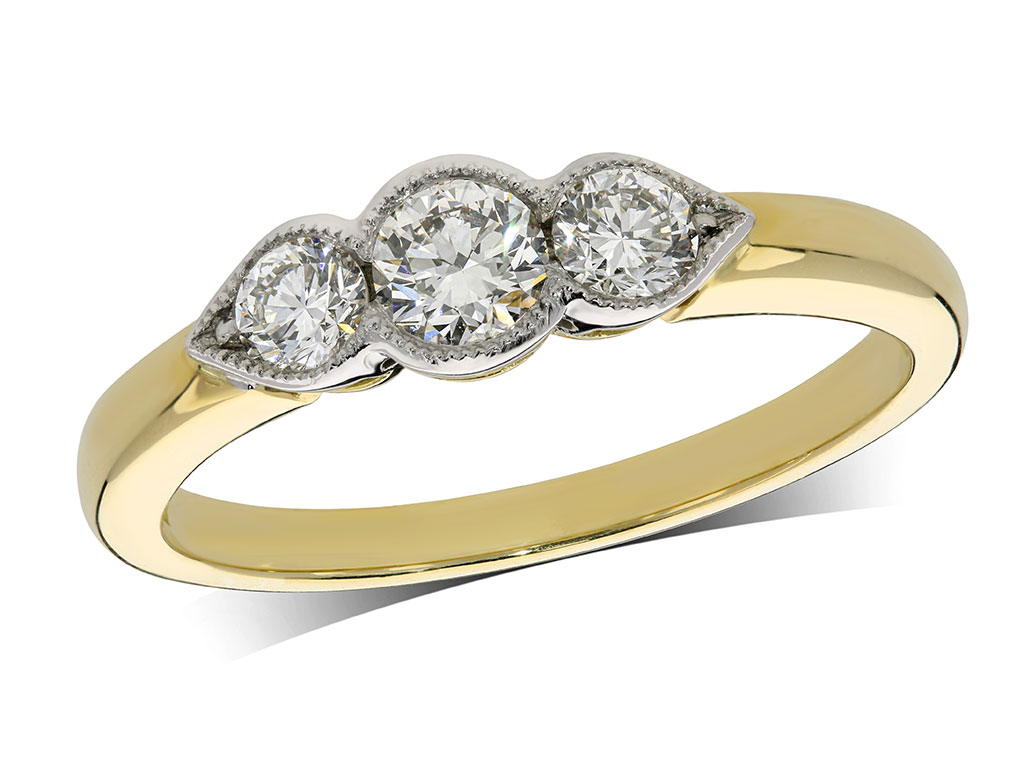 18 carat yellow gold set three stone diamond engagement ring, with a certificated brilliant cut centre in a rub over milligrained setting, and one brilliant cut on each shoulder. Perfect fit with a wedding ring. Total diamond weight: 0.52ct.