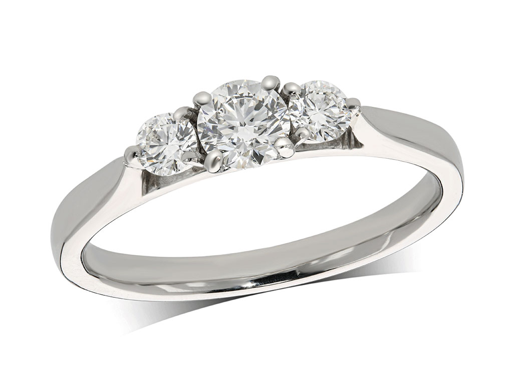 Platinum set three stone diamond engagement ring, with a certificated brilliant cut centre in a rub over milligrained setting, and one brilliant cut on each shoulder. Perfect fit with a wedding ring. Total diamond weight: 0.50ct.