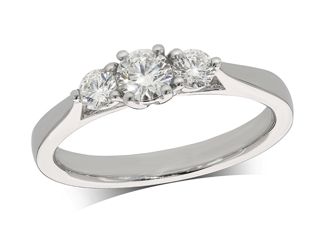 Platinum set three stone diamond engagement ring, with a certificated brilliant cut centre in a four claw setting, and one brilliant cut on each shoulder. Perfect fit with a wedding ring. Total diamond weight: 0.50ct.