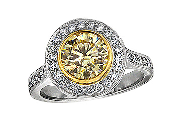 A 0.95ct centre, Brilliant, Fancy Yellow, Cluster diamond ring. You can buy online or reserve online and view in store at Jamieson and Carry, Aberdeen