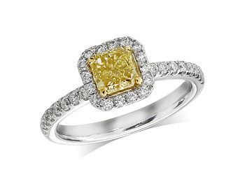 Platinum set diamond cluster engagement ring, with a certificated natural yellow cushion cut centre in a yellow gold four claw setting, surrounded by a diamond set cluster and shoulders. Total diamond weight: 0.87ct