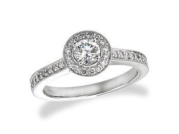 Platinum set diamond cluster engagement ring, with a certificated brilliant cut centre in a four claw setting, with a surrounding diamond set bezel and diamond set shoulders. Total diamond weight: 0.59ct.