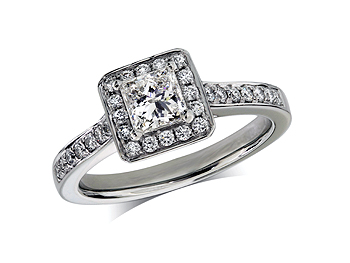 Platinum set diamond ring, with a certificated princess cut centre in a four claw setting, surrounded by a diamond set cluster and shoulders. Total diamond weight: 0.71ct.