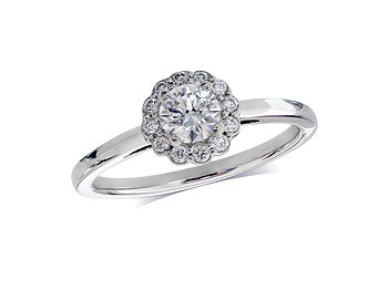 Platinum set diamond ring, with a certificated brilliant cut centre in a four claw setting, surrounded by a diamond set cluster.