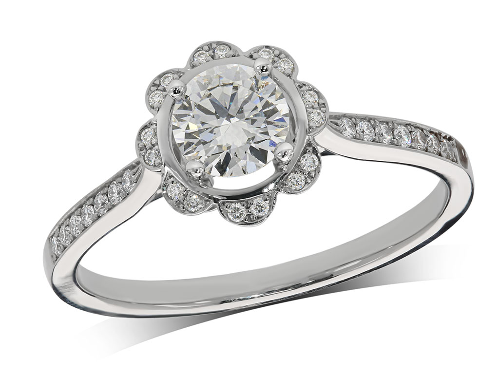 Platinum set diamond ring, with a certificated brilliant cut centre in a four claw setting, surrounded by a diamond set cluster, and diamond set shoulders. Total diamond weight: 0.60ct.