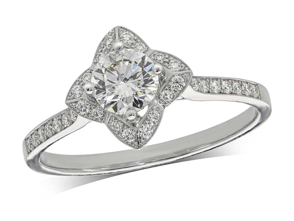 Platinum set diamond ring, with a certificated brilliant cut centre in a four claw setting, surrounded by a diamond set cluster, and diamond set shoulders. Total diamond weight: 0.63ct.
