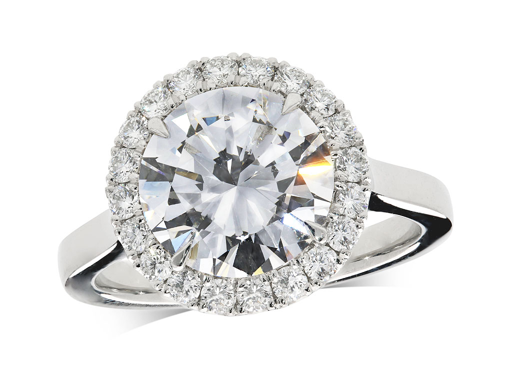 Platinum set diamond ring, with a certificated brilliant cut centre in a four claw setting, surrounded by a diamond set cluster. Total diamond weight: 0.3.44ct.