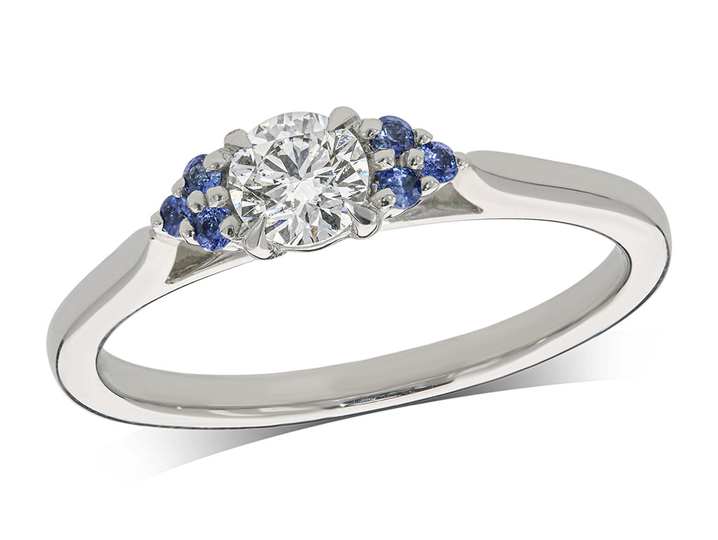 Platinum and 18 carat yellow gold set single stone diamond engagement ring, with a certificated brilliant cut centre in a four claw setting, and sapphire set shoulders. Total carat weight: 0.36ct.