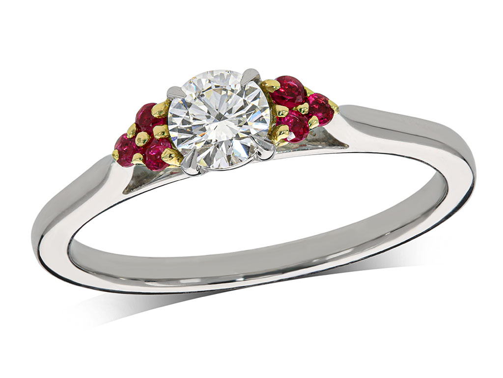 Platinum and 18 carat yellow gold set single stone diamond engagement ring, with a certificated brilliant cut centre in a four claw setting, and ruby set shoulders. Total carat weight: 0.37ct.