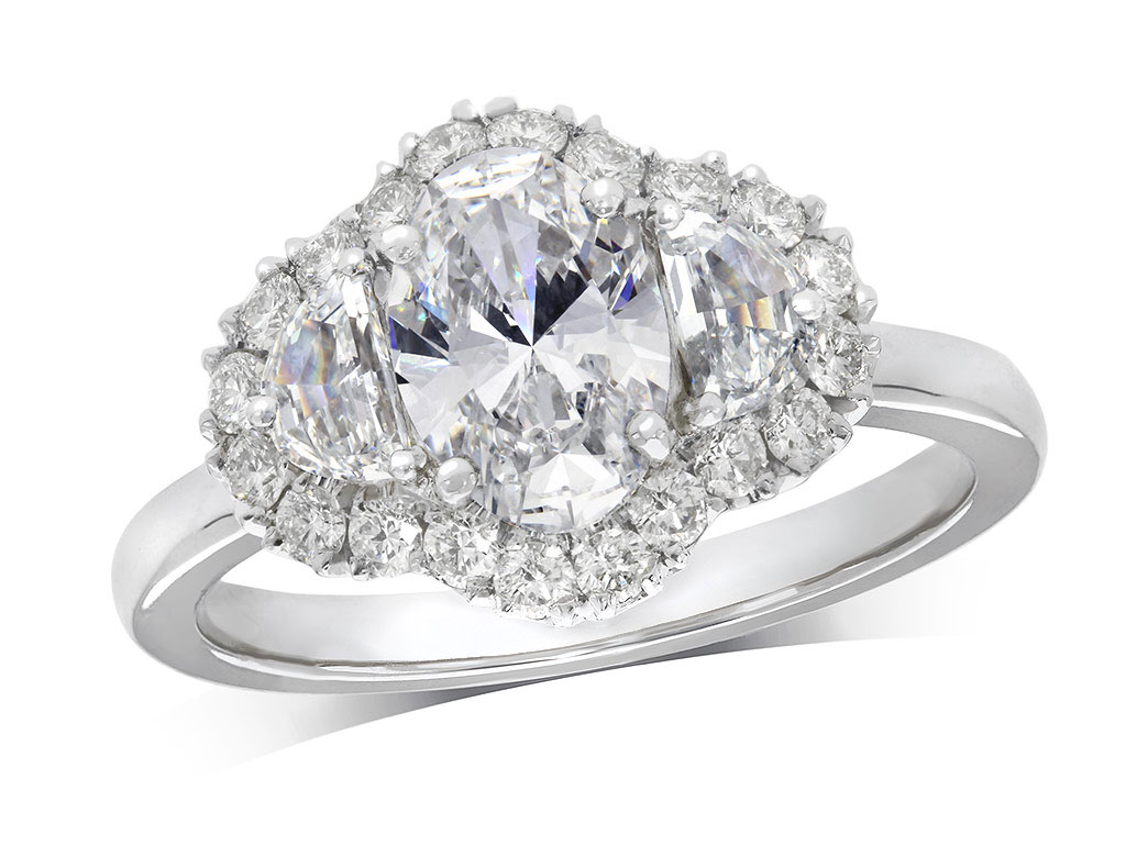 Platinum three stone diamond cluster engagement ring, with a certificated oval cut centre in a four claw setting, and one shield shaped diamond on each side, with a surrounding diamond set bezel. Total diamond weight: 1.75ct.