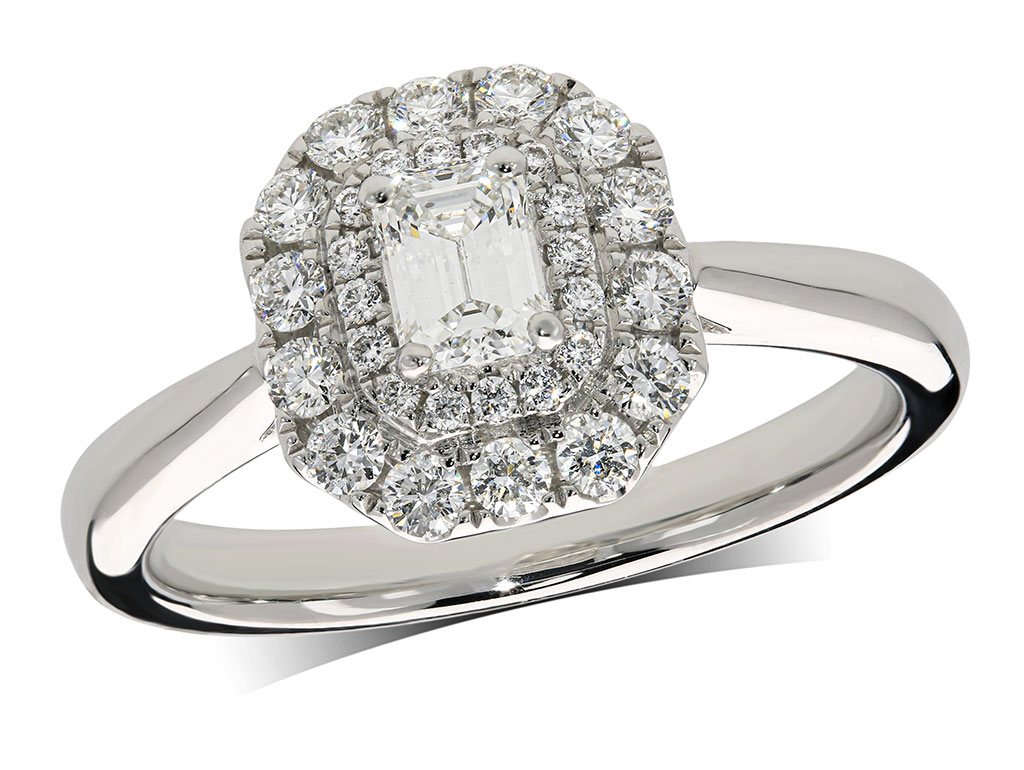 Platinum set diamond ring, with a certificated emerald cut centre in a four claw setting, surrounded by a double row diamond set cluster. Perfect fit with a wedding ring. Total diamond weight: 0.69ct.