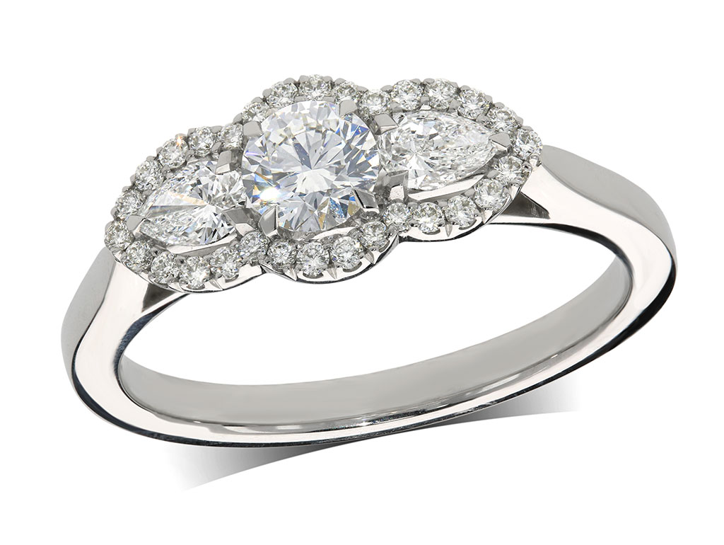 Platinum three stone diamond cluster engagement ring, with a certificated brilliant cut centre in a four claw setting, and one pear shaped diamond on each side, with a surrounding diamond set bezel. Total diamond weight: 0.70ct.