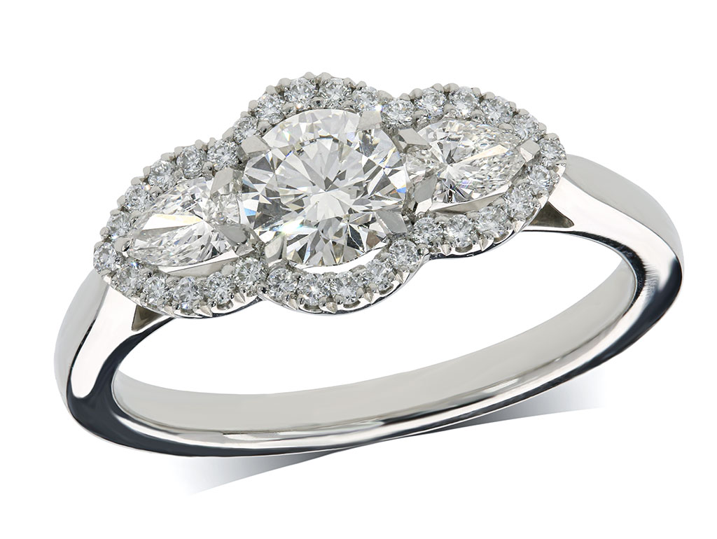 Platinum three stone diamond cluster engagement ring, with a certificated brilliant cut centre in a four claw setting, and one pear shaped diamond on each side, with a surrounding diamond set bezel. Total diamond weight: 0.98ct.