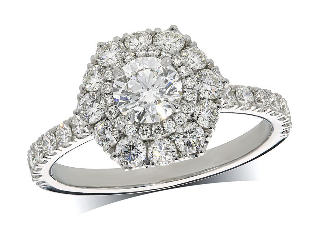 Platinum cluster diamond engagement ring, with a certificated brilliant cut centre in a four claw setting, with a surrounding double row diamond set bezel and diamond set shoulders. Total cluster diamond weight: 1.40ct.