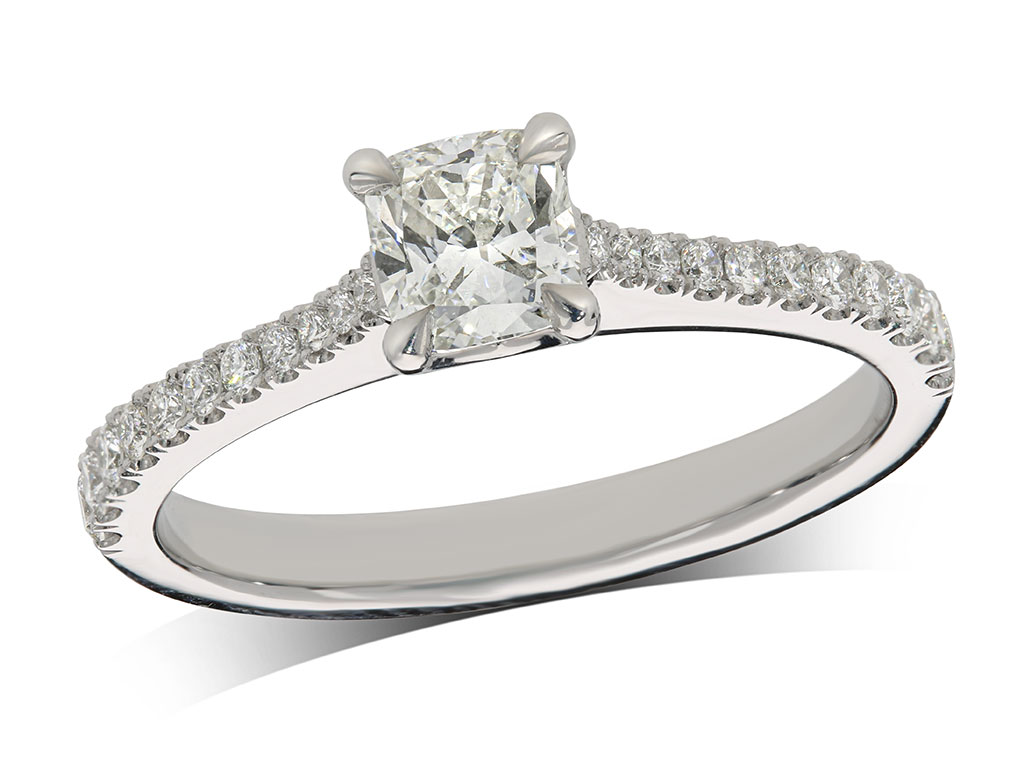 Platinum set single stone diamond engagement ring, with a certificated cushion cut centre in a four claw setting, and diamond set shoulders. Perfect fit with a wedding ring. Total diamond weight: 0.67ct.