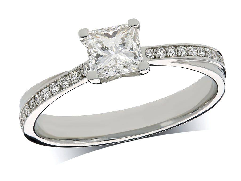 Platinum set single stone diamond engagement ring, with a certificated princess cut centre in a four claw setting, and diamond set shoulders. Perfect fit with a wedding ring. Total diamond weight: 0.55ct.