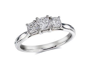 Platinum set three stone diamond engagement ring, with a certificated cushion cut centre in a four claw setting, and one cushion cut on each shoulder. Total diamond weight: 0.77ct.