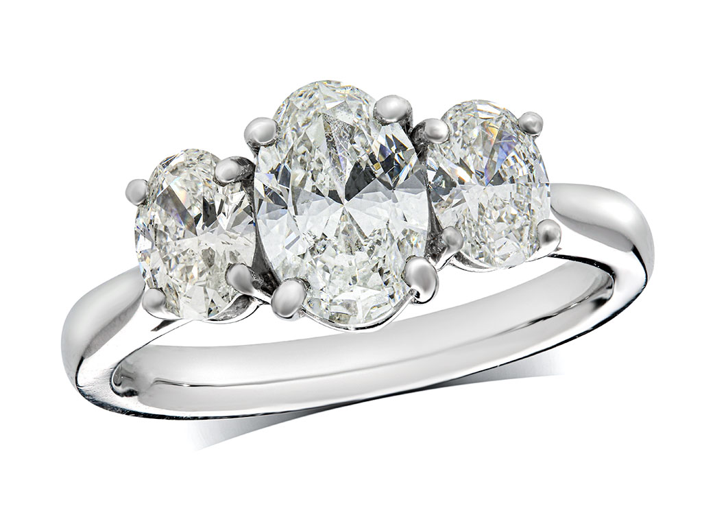 A 1.01ct centre, Oval, F, Three stone diamond ring. You can buy online or reserve online and view in store at Jamieson and Carry, Aberdeen