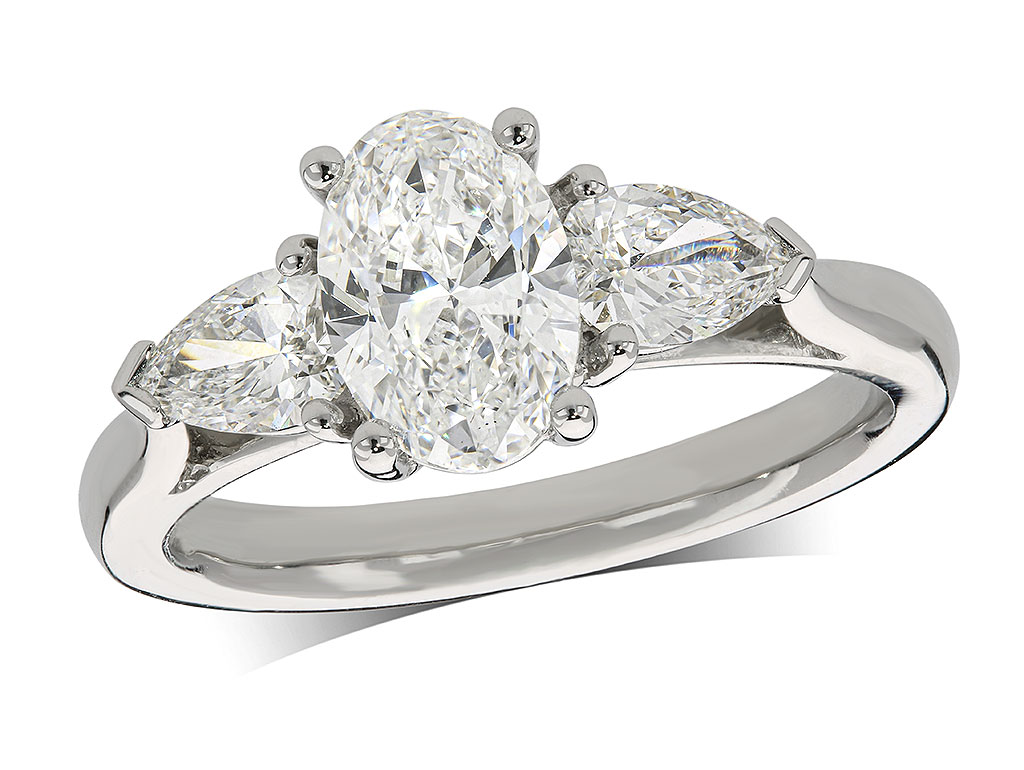 Platinum set single stone diamond engagement ring, with a certificated oval cut centre in a four claw setting, and one pear cut on each shoulder. Perfect fit with a wedding ring. Total diamond weight: 1.64ct.