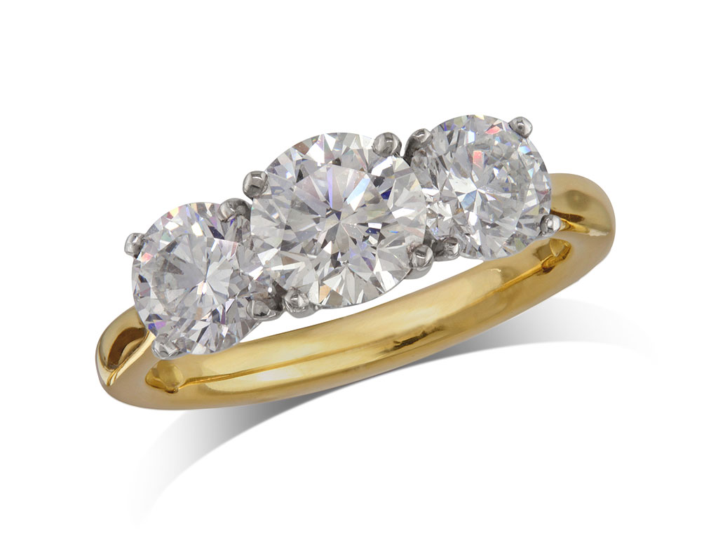 18 carat yellow gold set three stone diamond engagement ring, with a certificated brilliant cut centre in a four claw setting, and one brilliant cut on each shoulder. Perfect fit with a wedding ring. Total diamond weight: 2.29ct.