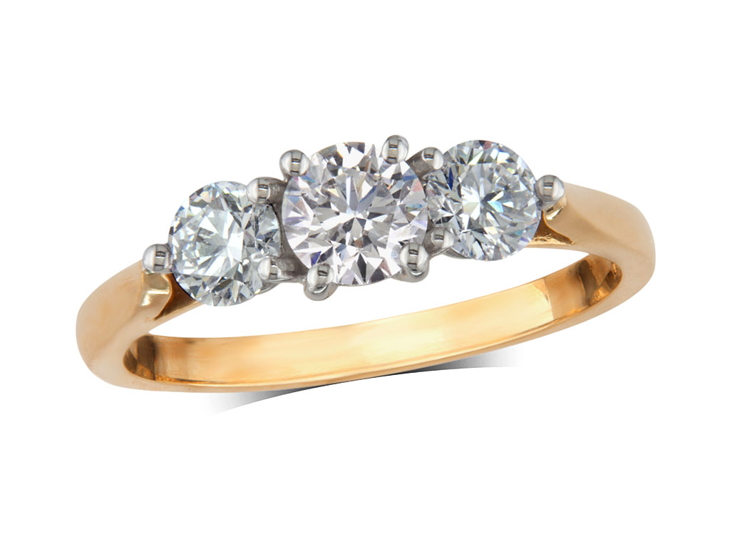 18 carat yellow gold set three stone diamond engagement ring, with a certificated brilliant cut centre in a four claw setting, and one brilliant cut on each shoulder. Perfect fit with a wedding ring. Total diamond weight: 1.25ct.