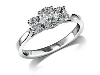 A 0.71ct centre, Oval, F, Three stone diamond ring. You can buy online or reserve online and view in store at Jamieson and Carry, Aberdeen