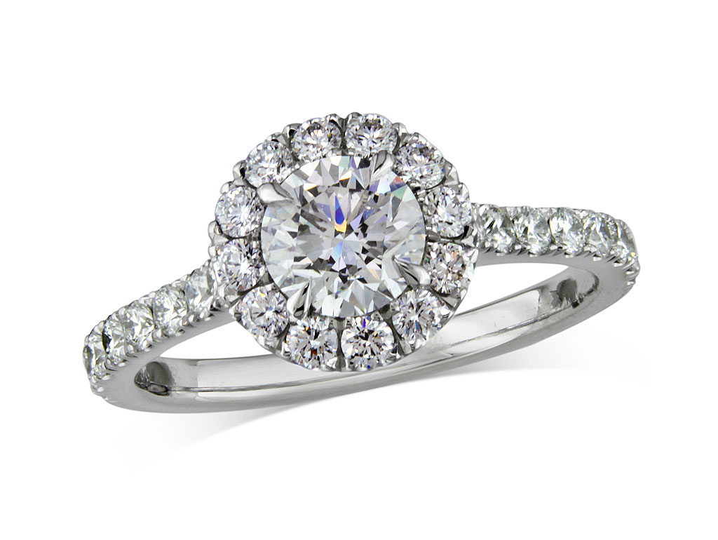 A 0.70ct centre, Brilliant, F, Cluster diamond ring. You can buy online or reserve online and view in store at Jamieson and Carry, Aberdeen