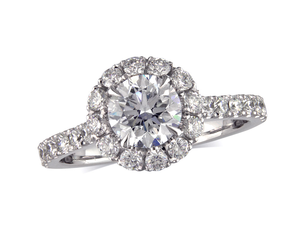 Platinum set diamond cluster engagement ring, with a certificated brilliant cut centre in a four claw setting, with a surrounding diamond set bezel. Total cluster diamond weight: 1.36ct.