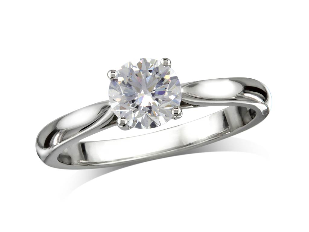 Platinum single stone diamond engagement ring, with a certificated brilliant cut, in a four claw setting. Perfect fit with a wedding ring.