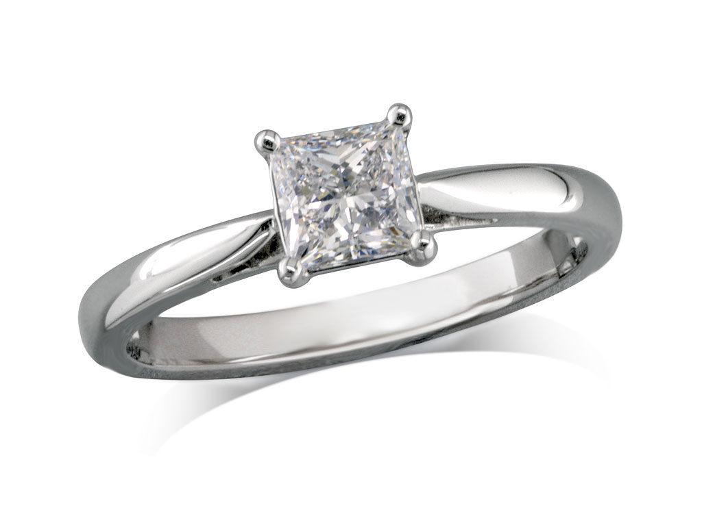 Platinum set single stone diamond engagement ring, with a certificated princess cut, in a four claw setting.