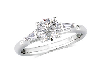 Platinum set single stone diamond engagement ring, with a certificated brilliant cut centre in a four claw setting, and one taper cut on each shoulder. Perfect fit with a wedding ring. Total diamond weight: 1.22ct.