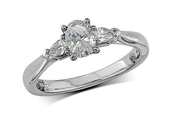 Platinum set single stone diamond engagement ring, with a certificated oval cut centre in a four claw setting, and one pear cut on each shoulder. Perfect fit with a wedding ring. Total diamond weight: 0.70ct.