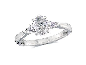 Platinum set single stone diamond engagement ring, with a certificated oval cut centre in a four claw setting, and one pear cut on each shoulder. Perfect fit with a wedding ring. Total diamond weight: 0.90ct.