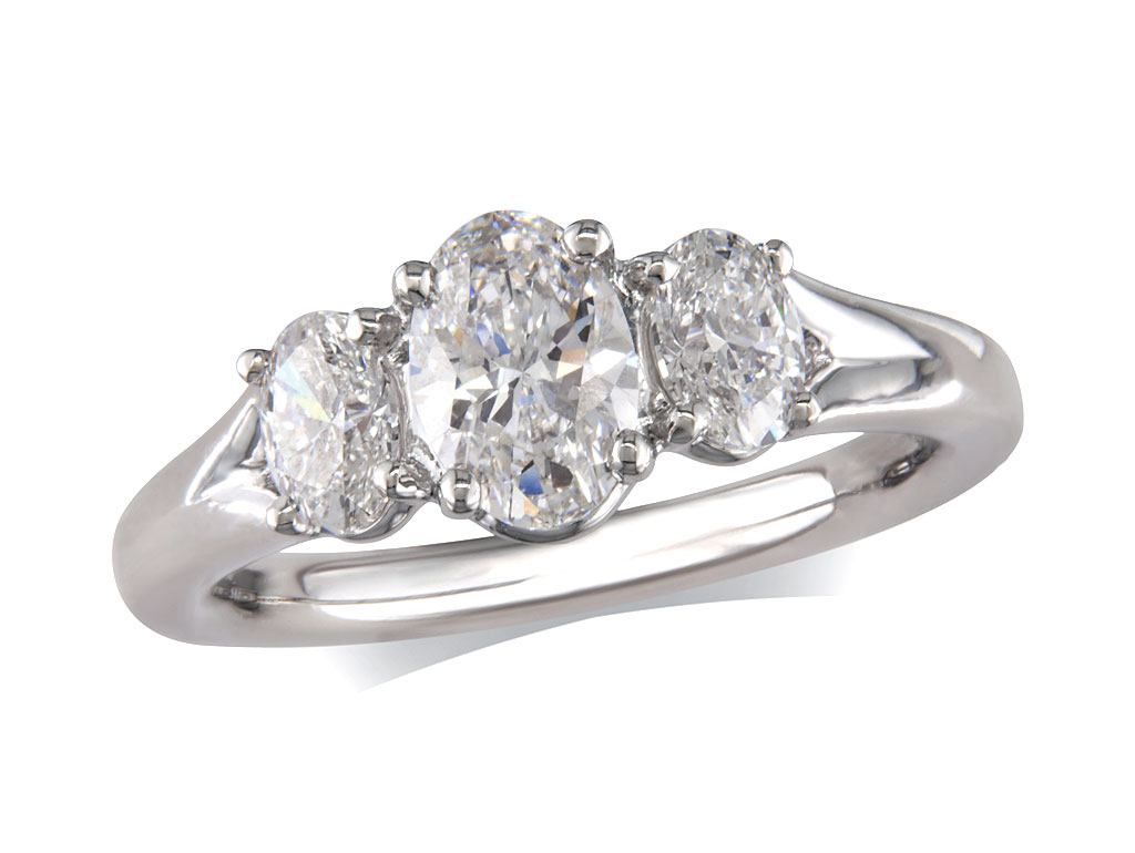 Platinum set three stone diamond engagement ring, with a certificated oval cut centre in a four claw setting, and one oval cut on each shoulder. Perfect fit with a wedding ring. Total diamond weight: 1.20ct.