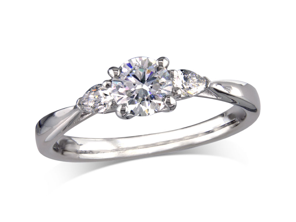 Platinum set single stone diamond engagement ring, with a certificated brilliant cut centre in a four claw setting, and one pear cut on each shoulder. Perfect fit with a wedding ring. Total diamond weight: 0.70ct.