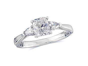 Platinum set single stone diamond engagement ring, with a certificated cushion cut centre in a four claw setting, and one pear cut on each shoulder. Perfect fit with a wedding ring. Total diamond weight: 1.23ct.