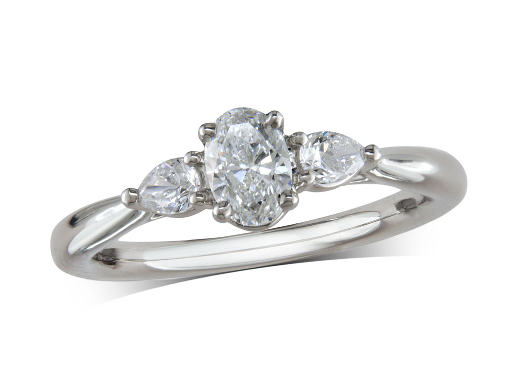 Platinum set single stone diamond engagement ring, with a certificated oval cut centre in a four claw setting, and one pear cut on each shoulder. Perfect fit with a wedding ring. Total diamond weight: 0.60ct.