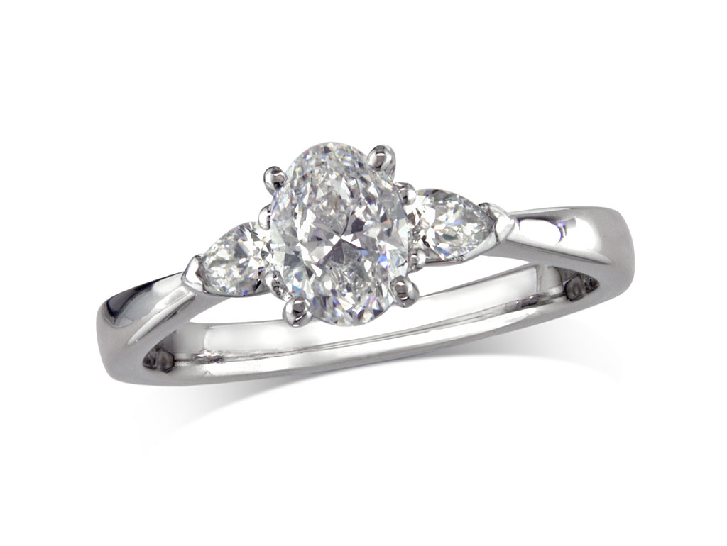 Platinum set single stone diamond engagement ring, with a certificated oval cut centre in a four claw setting, and one pear cut on each shoulder. Perfect fit with a wedding ring. Total diamond weight: 0.65ct.