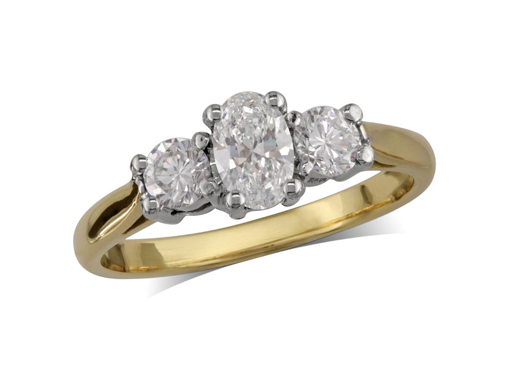 18 carat yellow gold set three stone diamond engagement ring, with a certificated oval cut centre in a four claw setting, and one brilliant cut on each shoulder. Total diamond weight: 0.56ct.